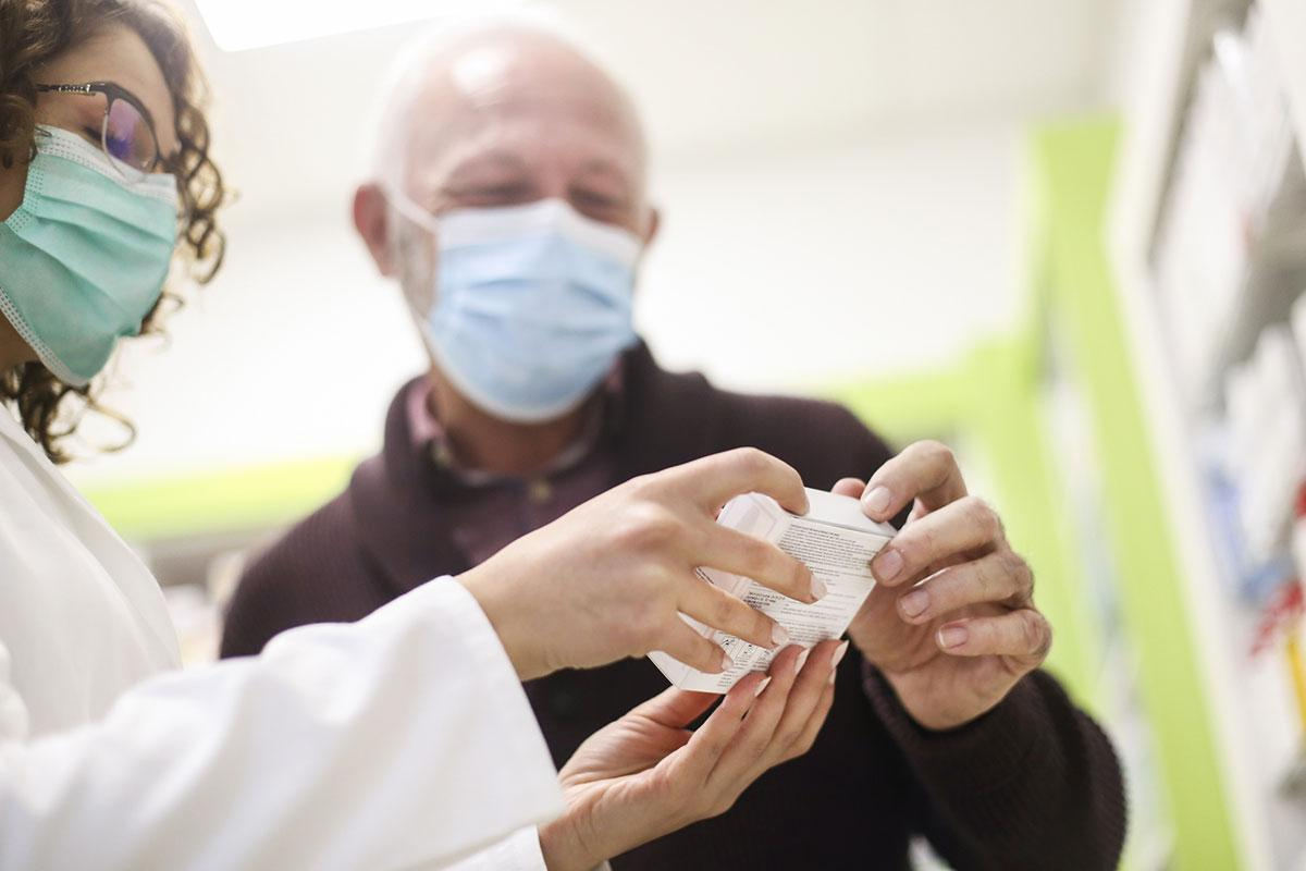 Man and pharmacist in a face mask