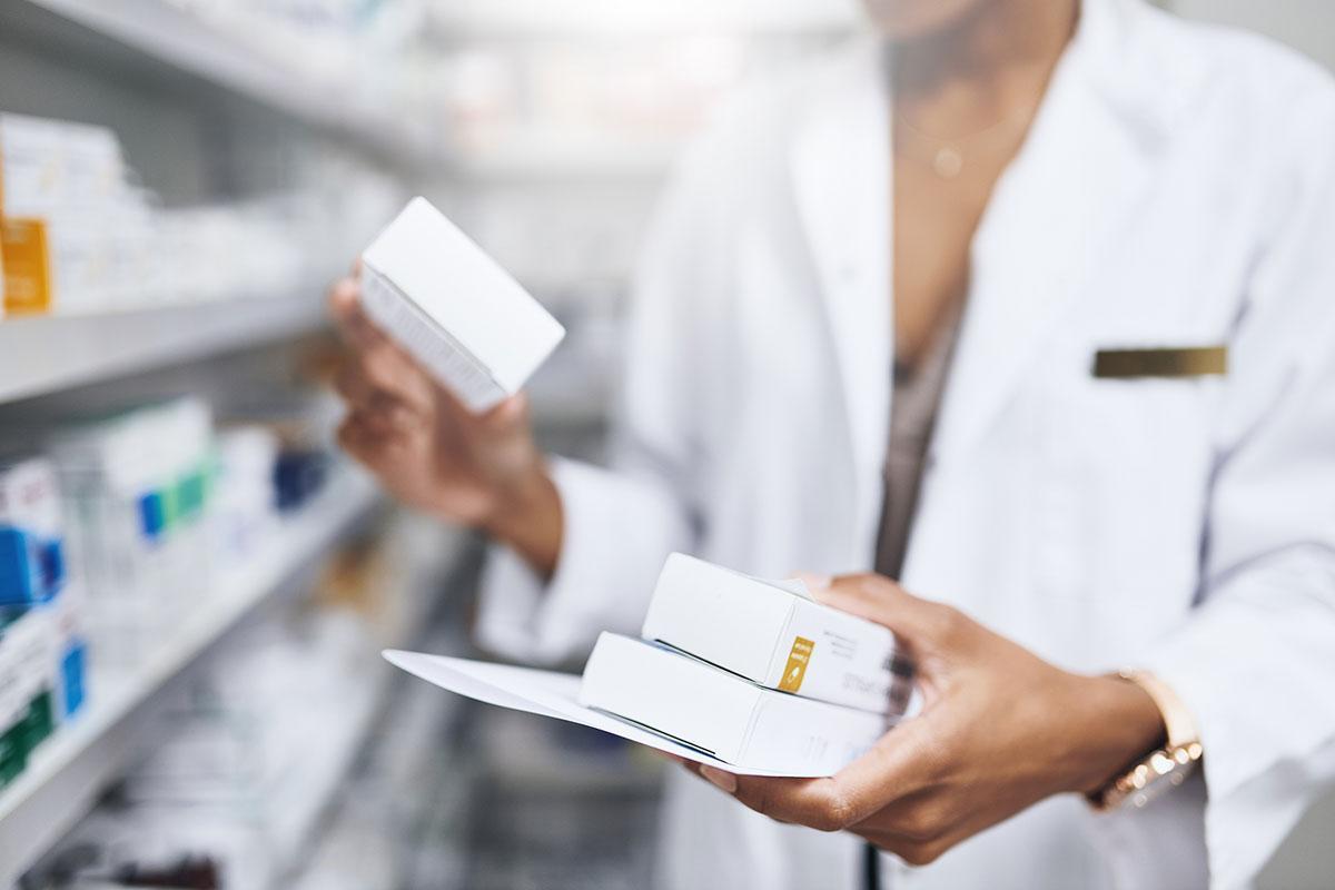 Pharmacist holding box of meds