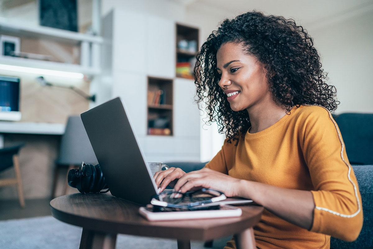 Beautiful woman on laptop smiling